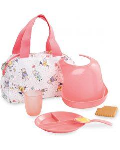 Corolle - Set di accessori composto da borsa, piatto, tazza, cucchiaio, bavaglino e biscotto